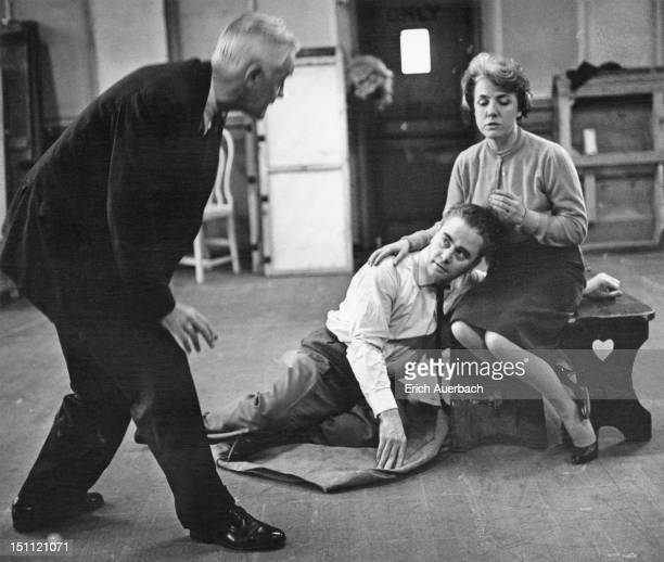 Left to right, producer and director Glen Byam Shaw directs tenor Alexander Young and Australian soprano Elsie Morison during a rehearsal for the...