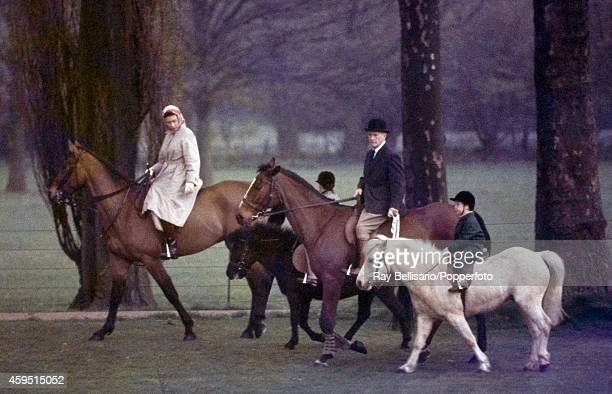Queen Elizabeth II riding Sultan and a groom leading Lord Linley riding Willy of Watersmeet with Prince Andrew riding Valkyrie behind in Windsor Park...