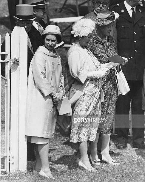 Queen Elizabeth II the Queen Mother and Mary Princess Royal at the Oaks Stakes Epsom Downs Racecourse Surrey 3rd June 1960