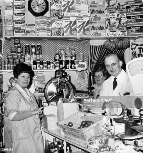 Left to right Rene Driver assistant and Mrs and Mr Reg Harris in their grocer's shop in Camberwell London