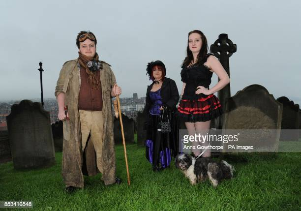 Left to right Rhys ThomasLindsay Jane Thomas Rhian ThomasLindsay and their dog Zelda stand in the grounds of St Mary's Church Whitby during the...