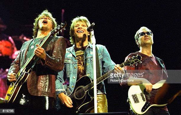 Left to right Richie Sambora Jon Bon Jovi and Hugh McDonald of the band Bon Jovi perform during the Universal Appeal Concert March 24 2001 at...