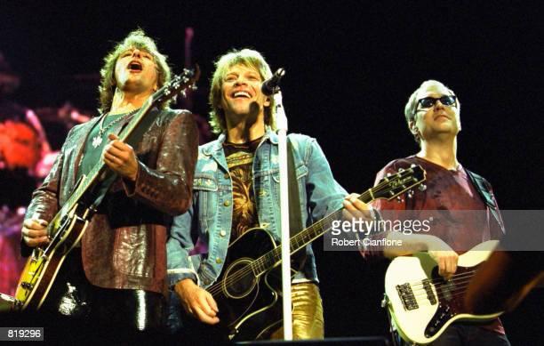 Left to right Richie Sambora Jon Bon Jovi and Hugh McDonald of the band Bon Jovi perform during the Universal Appeal Concert March 24 2001 at...