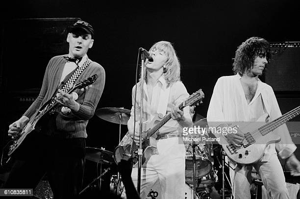 Rick Nielsen Robin Zander and Tom Petersson of American rock group Cheap Trick performing on stage USA 1978
