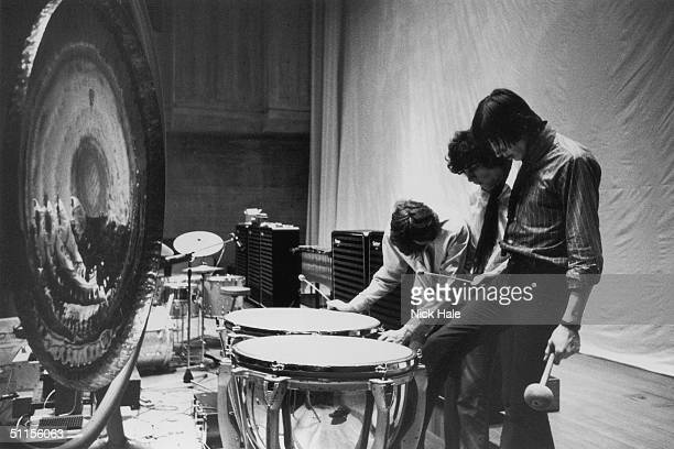 Rick Wright Syd Barrett and Roger Waters of British psychedelic rock group Pink Floyd at the timpani during rehearsals for their first concept show...