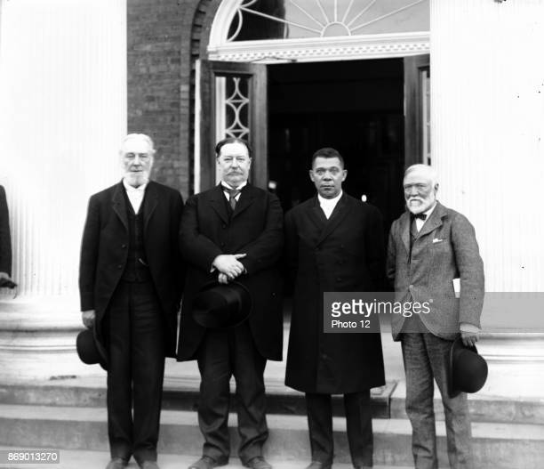 Left to right Robert C Ogden Senator William Howard Taft Booker T Washington and Andrew Carnegie standing on the steps of a building at the Tuskegee...