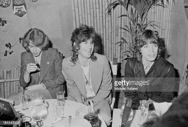 Rolling Stones guitarists Mick Taylor and Keith Richards with singer Mick Jagger at a press conference at the Sportpaleis AHOY Rotterdam Netherlands...