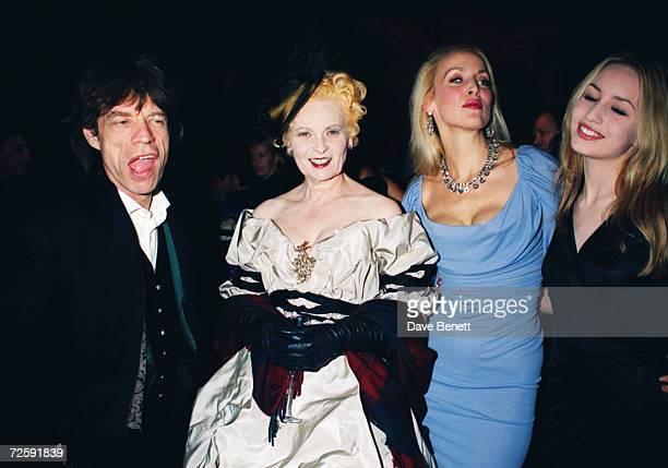 Rolling Stones singer Mick Jagger fashion designer Vivienne Westwood Jerry Hall and her daughter Elizabeth Jagger at a Westwood tribute by Moet...