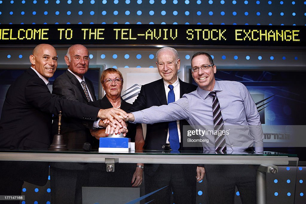 Left to right, Ron Malka, acting chairman of the Tel Aviv Stock Exchange, Yaakov Peri, Israel's minister of science, technology and space, Ester Levanon, chief executive officer of the Tel Aviv Stock Exchange, Phillip Frost, billionaire and chairman of Teva Pharmaceutical Industries Ltd. and Shai Novik, president of Prolor Biotech Inc., press the opening bell at the Tel Aviv Stock Exchange in Tel Aviv, Israel, on Wednesday, Aug. 21, 2013. Frost was at the Tel Aviv Stock Exchange to mark the listing of Opko Health Inc., of which he is the largest shareholder. Photographer: Ariel Jerozolimski/Bloomberg via Getty Images
