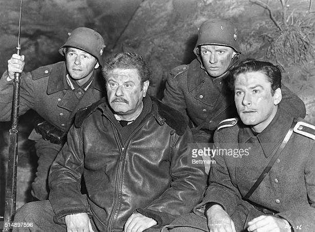 Ronald Reagan Alan Hale Arthur Kennedy and Errol Flynn dressed as soldiers in a scene from the 1942 Warner Bros production of 'Desperate Journey'...