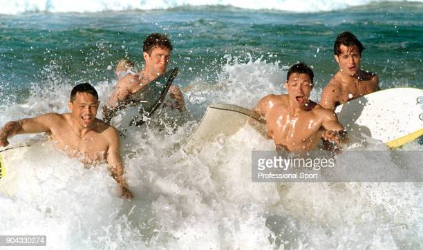 Rory Underwood Phil de Glanville Tony Underwood and Kyran Bracken of England take a surfing break during the Rugby Union World Cup in South Africa...