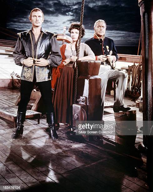 Russian actor Yul Brynner English actress Claire Bloom and French actor Charles Boyer in 'The Buccaneer' directed by Anthony Quinn 1958 This was...