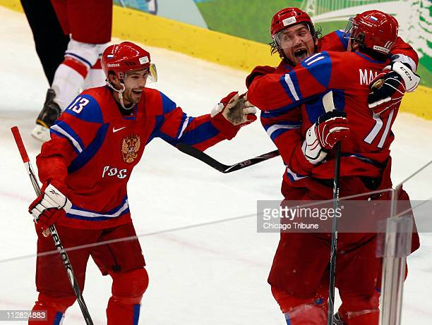 Left to right Russia's Pavel Datsyuk Alexander Ovechkin and Evgeni Malkin celebrate Malkin's goal against the Czech Republic during the firist period...