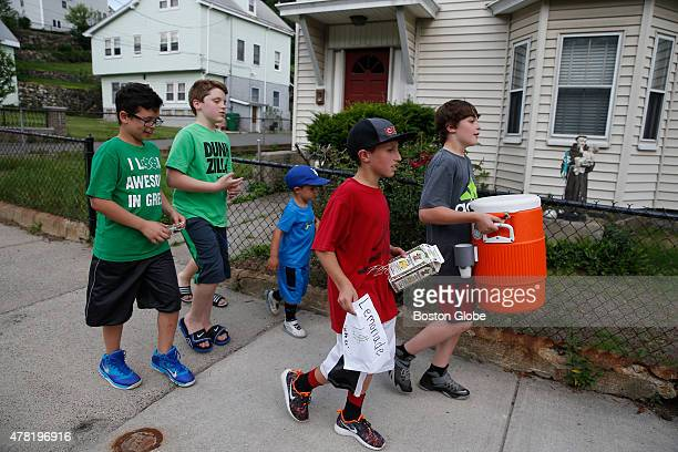 Left to right Ryan Monaco Joey Falco Cameron Lind his brother Anthony and Jonathan Rogers walk down Fulton Street after selling all of their lemonade...