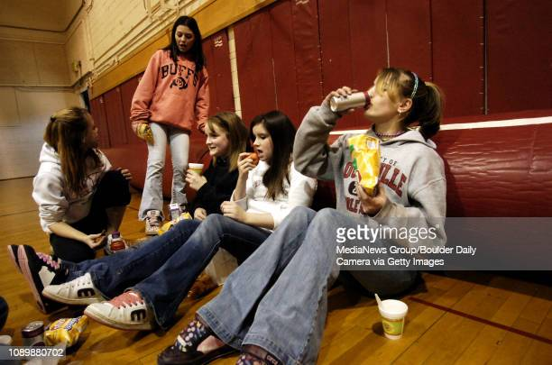 Left to right Sarah Olson Jacque Howard Aina Sandford Katie Sexton and Ali Hancock eat lunch in the small gym at Louisville Middle School which...