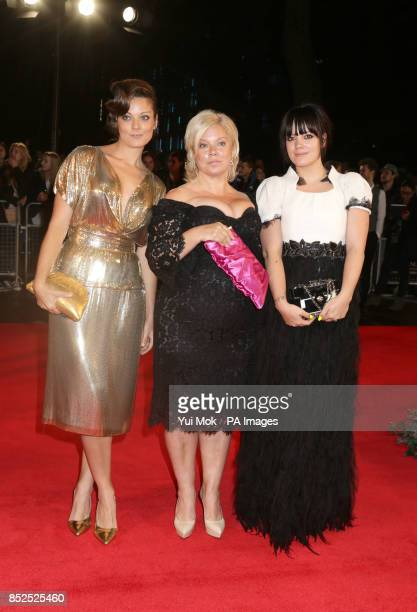 Left to right Sarah Owen Alison Owen and Lily Allen at the gala screening of Saving Mr Banks the closing film of the 57th BFI London Film Festival at...
