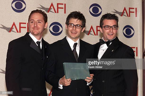 Left to right Scott Grimes Rick Gomez and Frank John Hughes winner for Movie or MiniSeries of the Year backstage at the inaugural AFI Awards 2001...