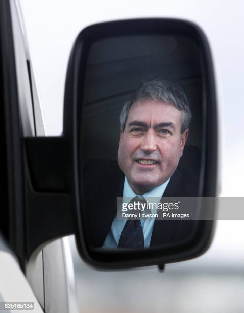 Left to right Scottish Labour leader Iain Gray is seen reflected in the wing mirror of an electric car by Scottish company Allied Vehicles in Dundee