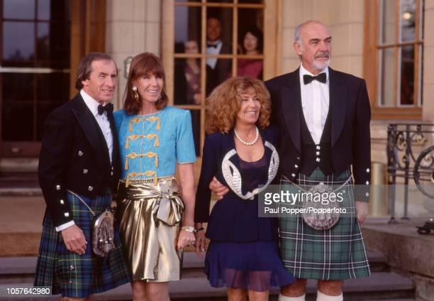 Scottish motor racing driver Jackie Stewart with his wife Helen and Scottish actor Sean Connery with his wife Micheline Roquebrune prior to attending...
