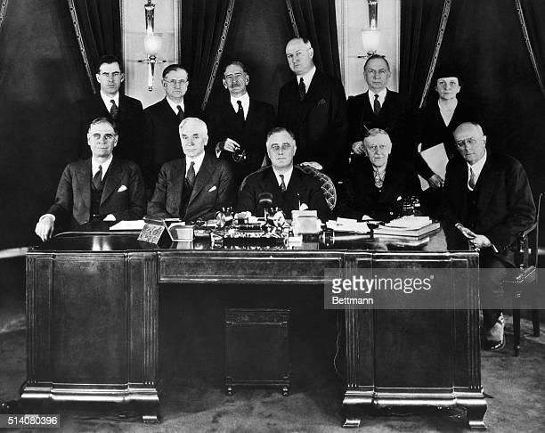 Secretary of War George H. Dern, Secretary of State Cordell Hull, President Roosevelt, Secretary of the Treasury William Hartman Woodin, and Attorney...