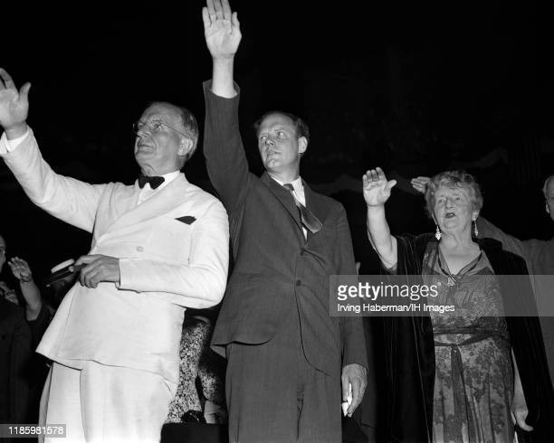 Senator Burton K Wheeler Charles Lindbergh and novelist Kathleen Norris pledge allegiance to the American flag at an America First Committee rally at...