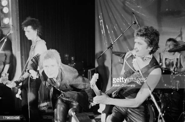 Sid Vicious Johnny Rotten Steve Jones and Paul Cook of British punk band the Sex Pistols perform on stage at a free concert for the children of...