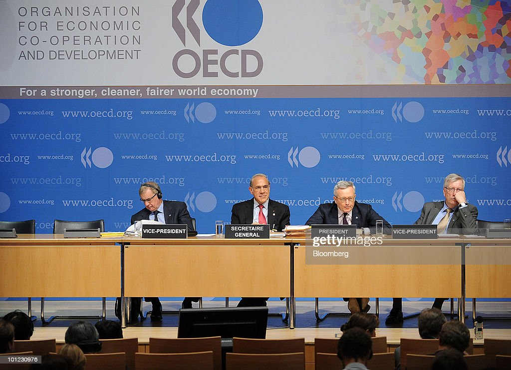 Simon Crean, Australia's trade minister, Angel Gurria, secretary-general of the Organisation of Economic Cooperation and Development (OECD), Giulio Tremonti, Italy's finance minister, and Sigbjorn Johnsen, Norway's finance minister, hold a news conference at the Organisation for Economic Cooperation and Development (OECD) headquarters in Paris, France, on Friday, May 28, 2010. Slovenia, along with Israel and Estonia, are joining the Paris-based organization of 31 of the world's most developed economies. Photographer: Antoine Antoniol/Bloomberg via Getty Images