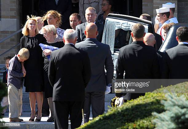 Left to right sister of former US Navy Seal Glen Doherty Kate Quigley and her son Cam with Doherty's mother Barbara Doherty following his funeral at...