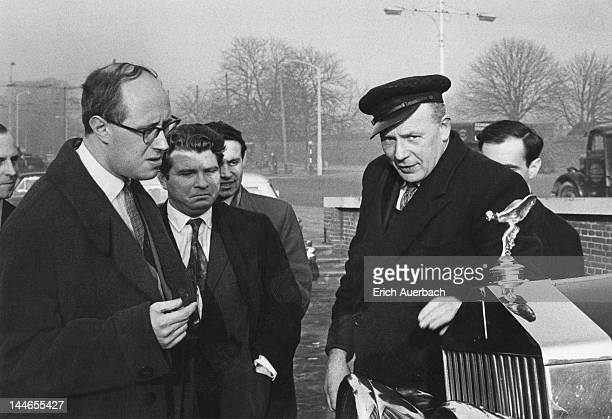 Soviet musicians cellist Mstislav Rostropovich and pianist Emil Gilels with a chauffeur and his RollsRoyce outside Hampton Court Palace London 19th...