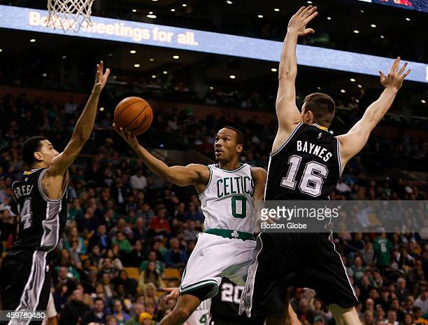 Left to right Spurs Danny Green goes up to block the shot of Celtics Avery Bradley as Spurs Aron Baynes guards Bradley during the second half The...