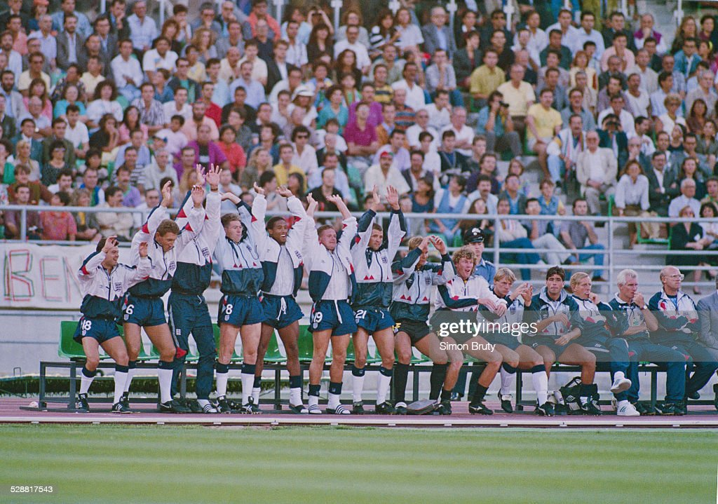 Left to right Steve Hodge,Terry Butcher,Chris Waddle, John Barnes, Paul Gazza Gascoigne, Steve Bull, Chris Woods, Dave Beasant, Stuart Pearce and Neil Webb of England perform the 'Mexican Wave' from the substitutes bench during the 1990 FIFA World Cup 3rd and 4th place playoff match against Italy on 7 July 1990 at the Sant Nicola Stadium in Bari, Italy.