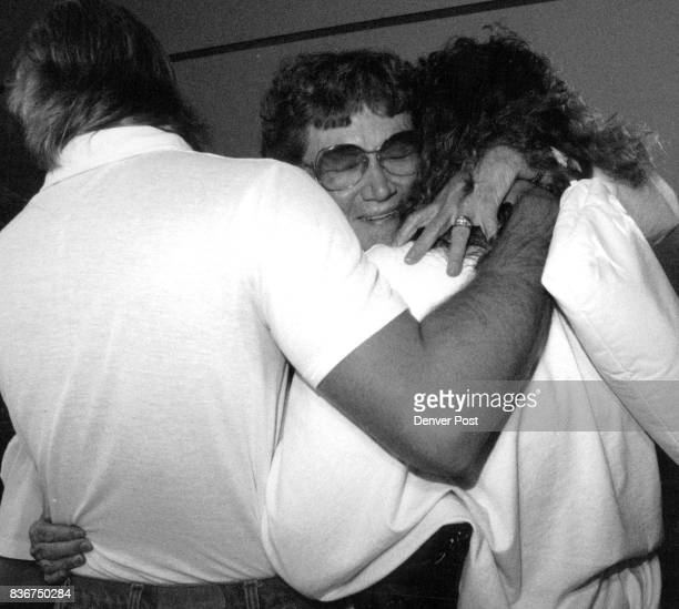 Steven Hunt hugs Dorothy Hendricks along with his wife Tammy Hunt from Ft Collins as Dorathy arrived from Bejieng at Stapleton Int airport Credit The...