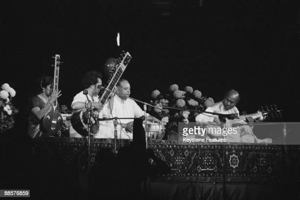 tanpura player Kamala Chakravarty sitar player Ravi Shankar tabla player Alla Rakha and sarod player Ali Akbar Khan performing at The Concert for...