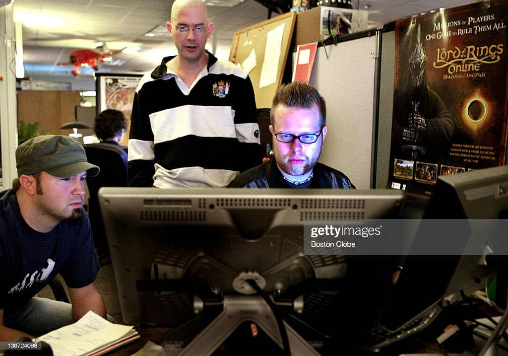 Left to right, tech artists Steven Ashley, Harry Teasley, and Matt Regnier work on an online game at Turbine Inc. in Westwood, Wednesday, July 23, 2008.