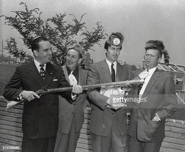 Tennessee Governor Frank Clement pays a visit to producer Walt Disney and actors Fess Parker and Buddy Ebsen of the Davy Crockett films Parker's...