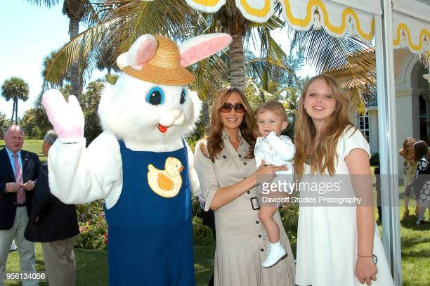 Left to right the Easter Bunny Melania Trump and son Barron and Tiffany Trump attend Easter Sunday events at the MaraLago Club on Easter Sunday Palm...