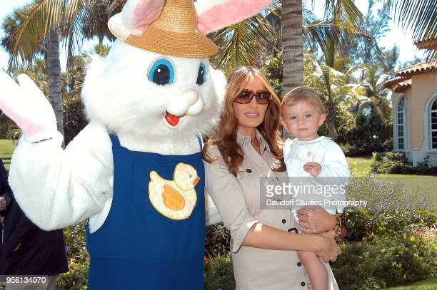 Left to right the Easter Bunny Melania Trump and son Barron attend Easter Sunday events at the MaraLago Club on Easter Sunday Palm Beach Florida...
