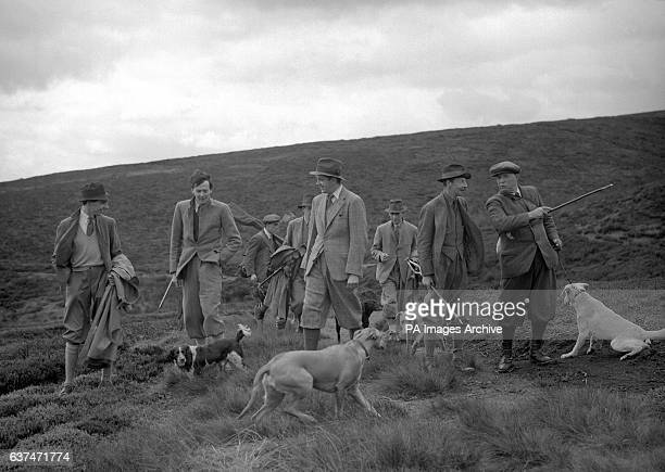 Left to right The Hon Major David Ormsby Gore Lord Hartington the Hon Robert Cecil and the Duke of Devonshire speaking to Mr Stitt the Head Keeper on...