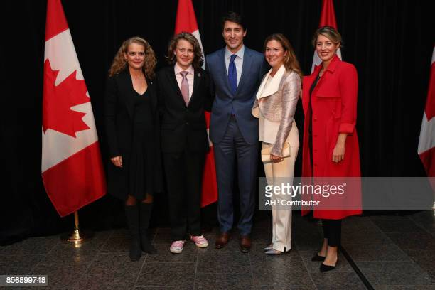 The new Governor General Julie Payette her son Laurier Payette Flynn Prime Minister Justin Trudeau Sophie Grégoire Trudeau and the Minister of...