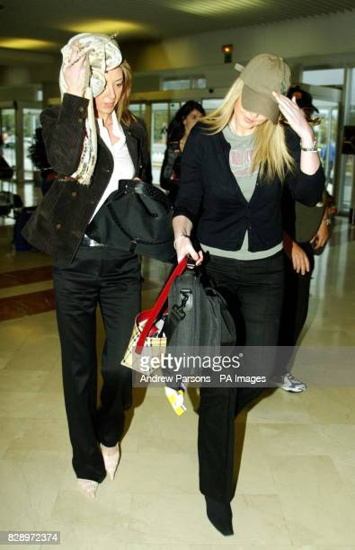 The wife of Leicester City Player Paul Dickov Janet and Keith Gillespie's partner Kelly Maguire arrive at Alicante airport Spain Keith Gillespie and...
