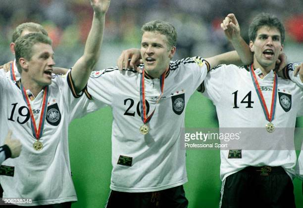 Thomas Strunz Oliver Bierhoff and Markus Babbel of Germany wearing their winners' medals following the UEFA Euro96 final at Wembley Stadium in London...
