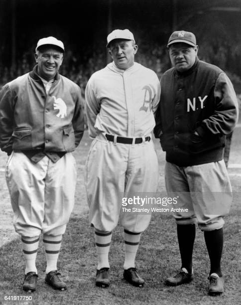 Left to Right - Tris Speaker, Ty Cobb center both with the Philadelphia Athletics, pose for a portrait with New York Yankees, Babe Ruth before a game...