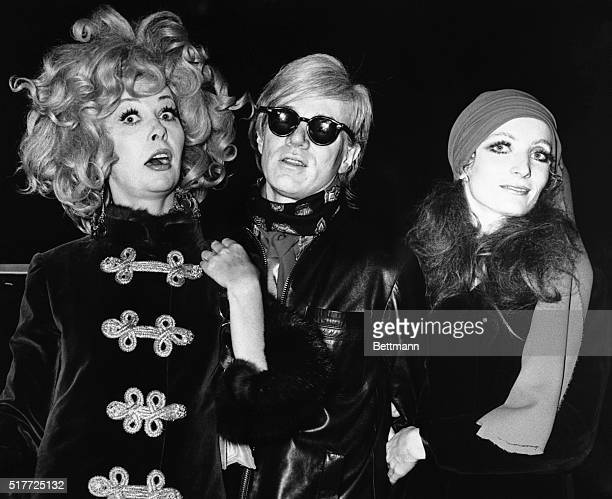 Ultra Violet Andy Warhol and unidentified friend arrive at the TransLux Theater for the premiere of 'I Love You Alice B Toklas' 10/7/1968 BPA