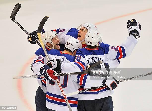 S Brian Rafalski, USA's Ryan Suter, USA's Paul Stastny, and USA's Zach Parise celebrate a goal during Canada vs. USA preliminary round Ice Hockey...