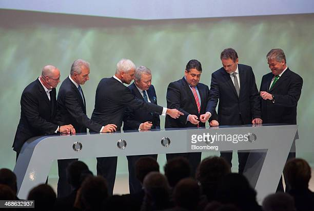 Left to right Uwe Hueck deputy chairman of Porsche AG Stanislaw Tillich prime minister of Saxony state Matthias Mueller chief executive officer of...