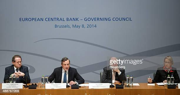 Left to right Vitor Constancio vice president of the European Central Bank pauses as Mario Draghi president of the European Central Bank speaks...