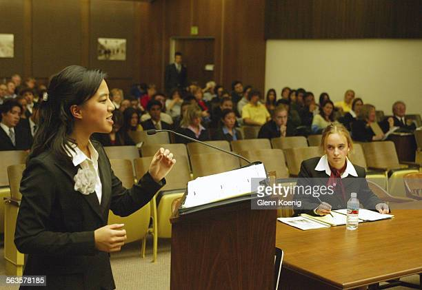 Left to right Vivienne Nguyen of Canyon High School gives the Pretrial Motion for the Prosecution as Defense team member Flavia de la Fuente of...