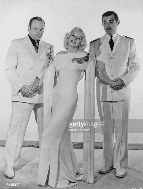 Wallace Beery Jean Harlow and Clark Gable in a promotional portrait for 'China Seas' directed by Tay Garnett 1935
