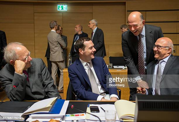 Left to right Wolfgang Schaeuble Germany's finance minister George Osborne UK chancellor of the exchequer Michel Sapin France's finance minister and...
