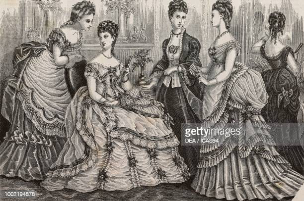 Left to right women wearing silk gauze faye and tarlatan satin tulle and taffeta and faye and tulle evening dresses Madame Fladry designs France...